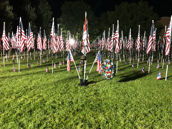 Field grave surrounded by flags Brecksville OH
